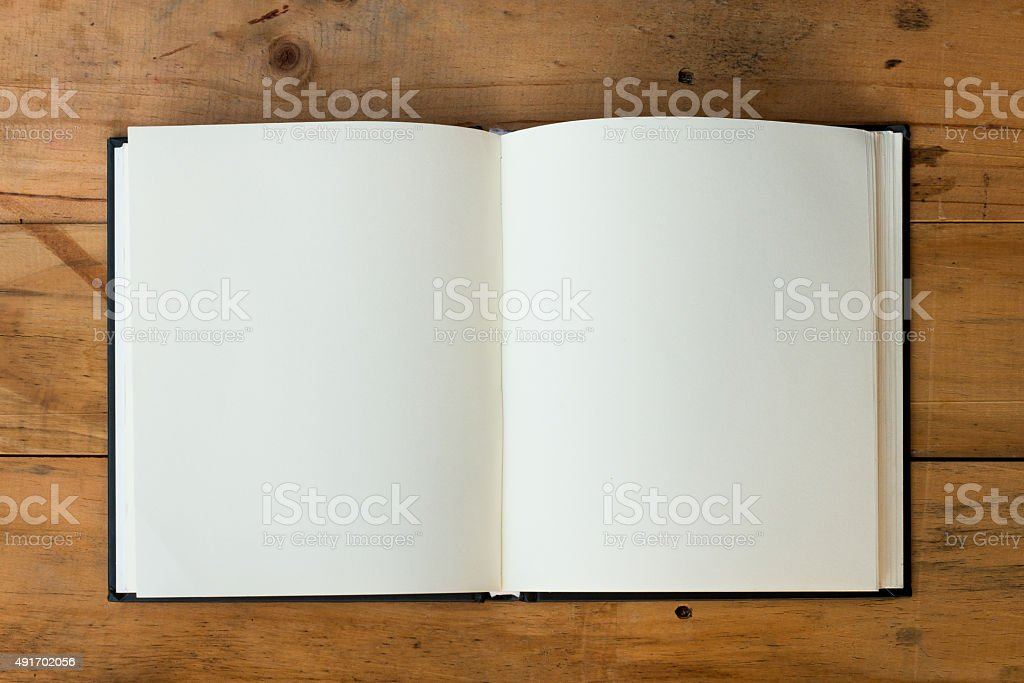 open book on wood table stock photo