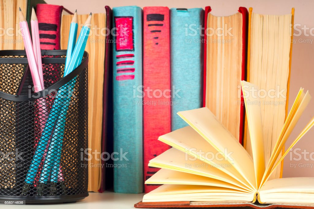 Open book, stack of colorful hardback books Back to school. . Education background. stock photo