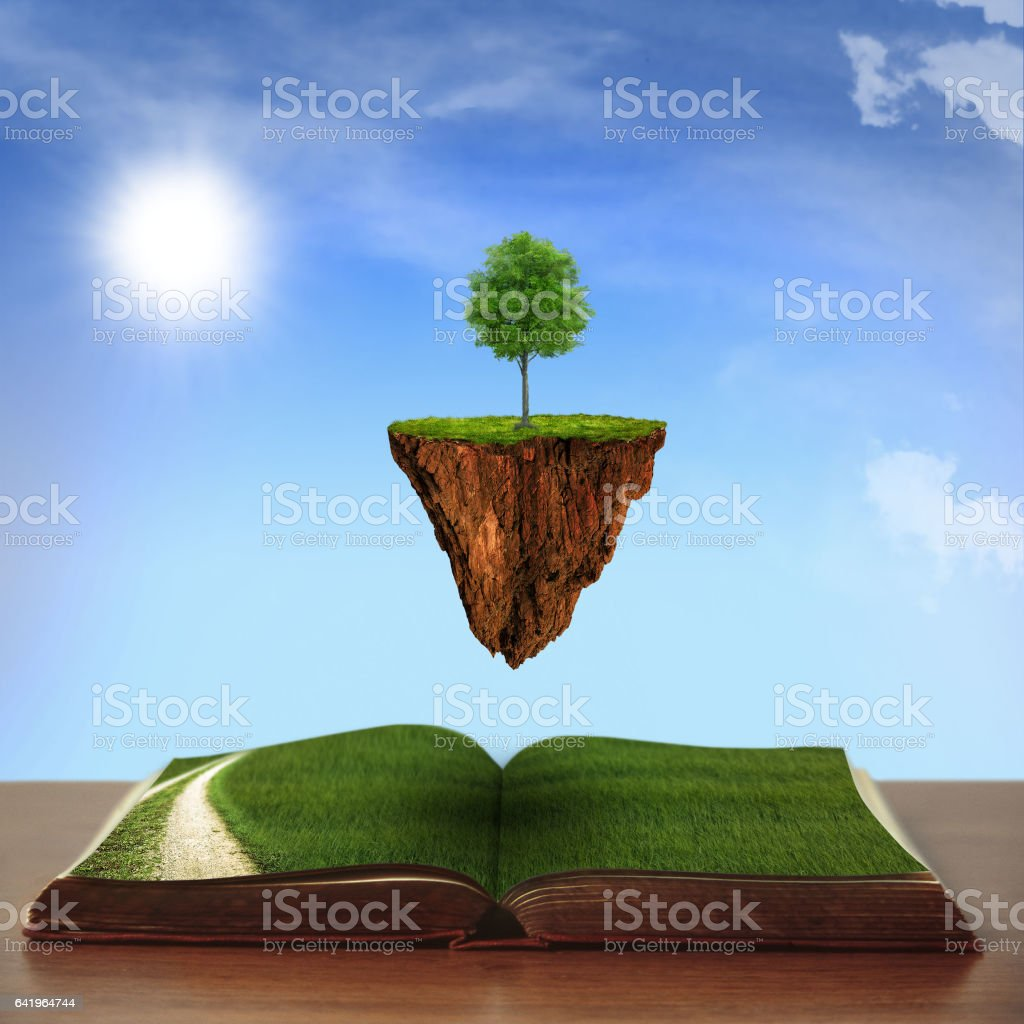 open book with country views with climbing tree stock photo