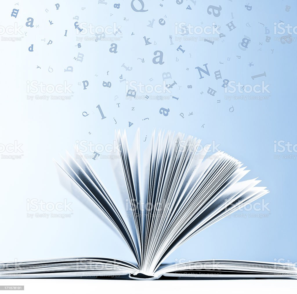 Open book with flying, scattered letters isolated on blue background stock photo