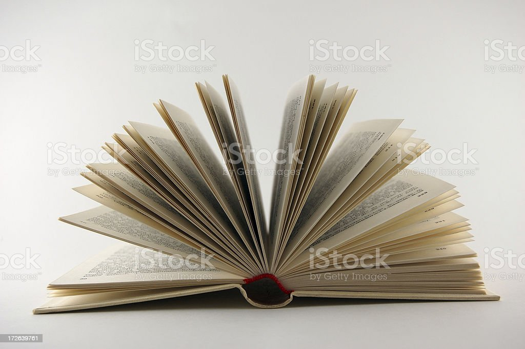 Open Book With Page Roll royalty-free stock photo