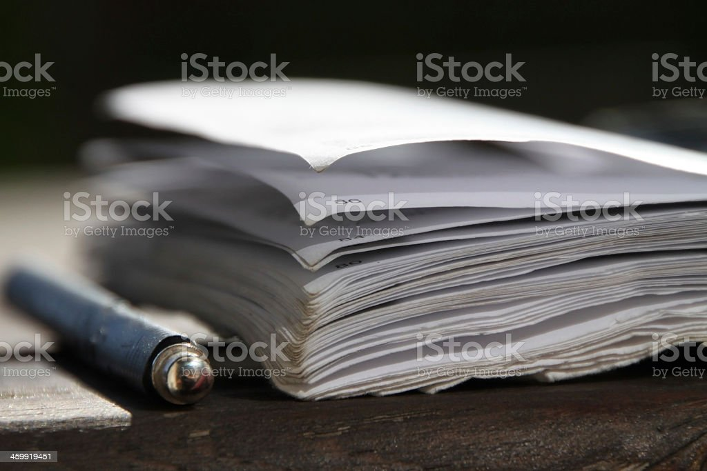 Open book with pencil stock photo
