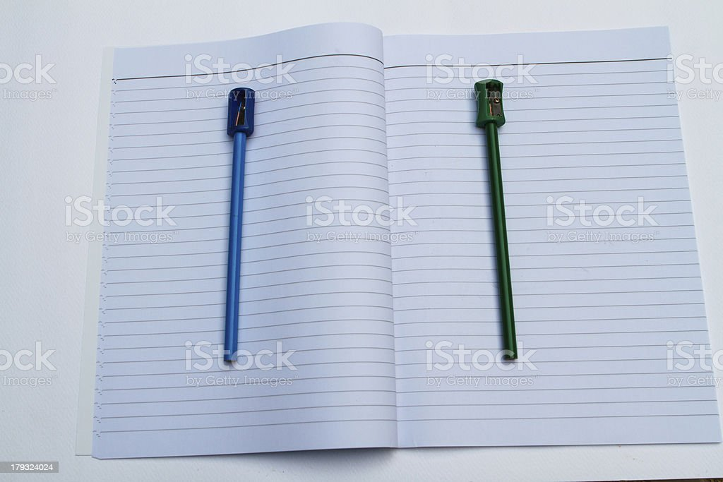 Open Book with pencil Sharpener royalty-free stock photo
