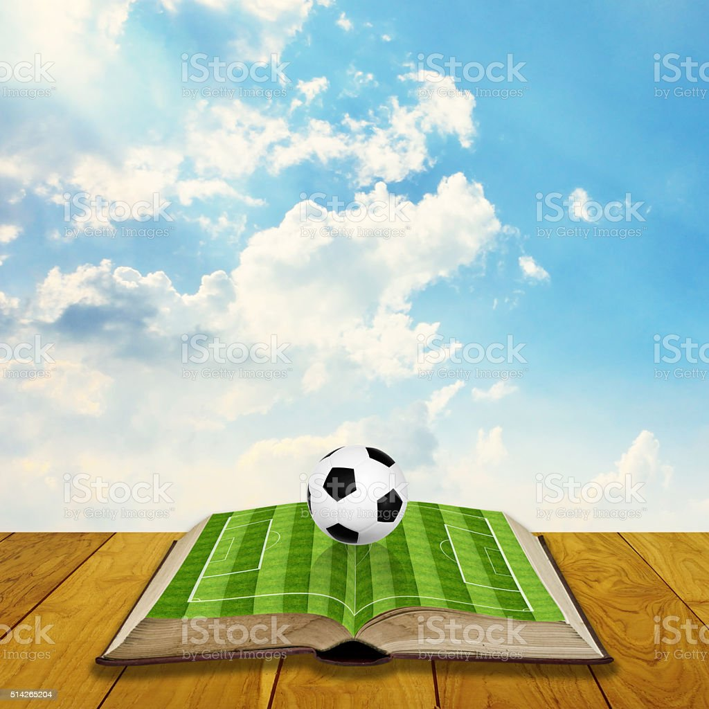 Open book with soccer filed stock photo