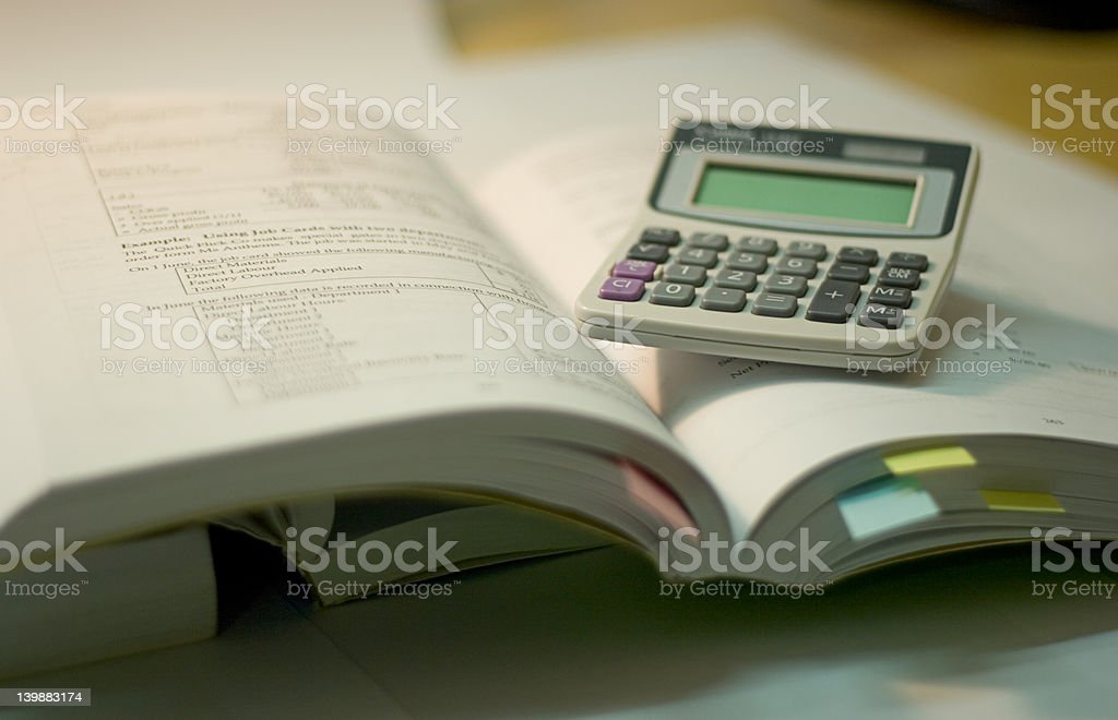 Open books and calculator royalty-free stock photo