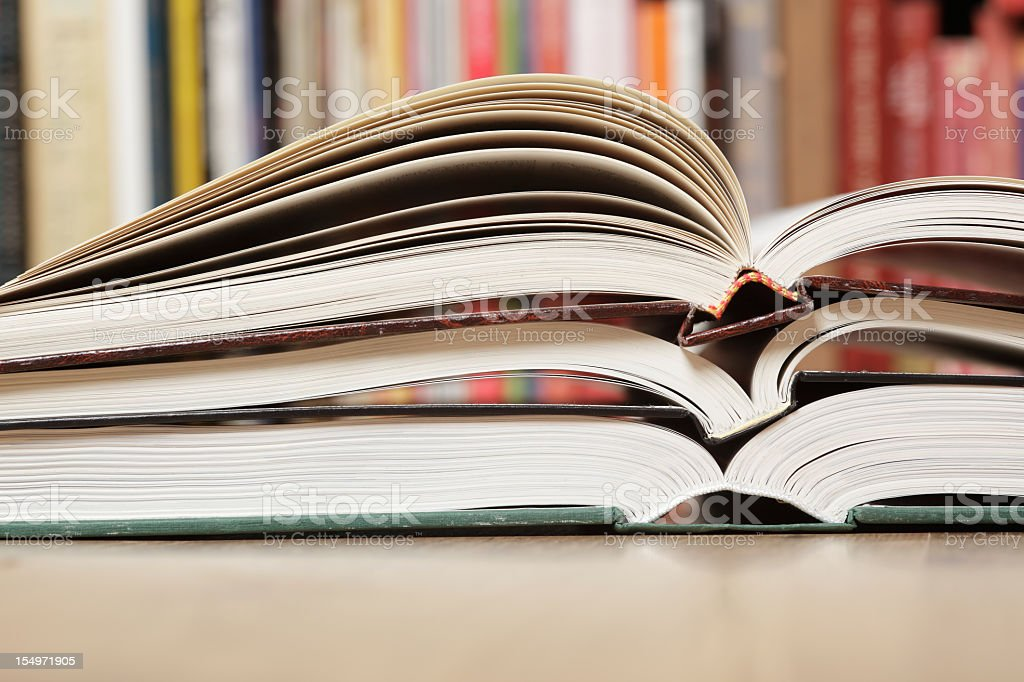 Open books staked on top of each other in the library royalty-free stock photo