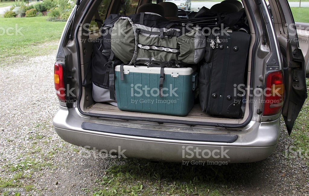 Open boot of a car filled with camping gear stock photo
