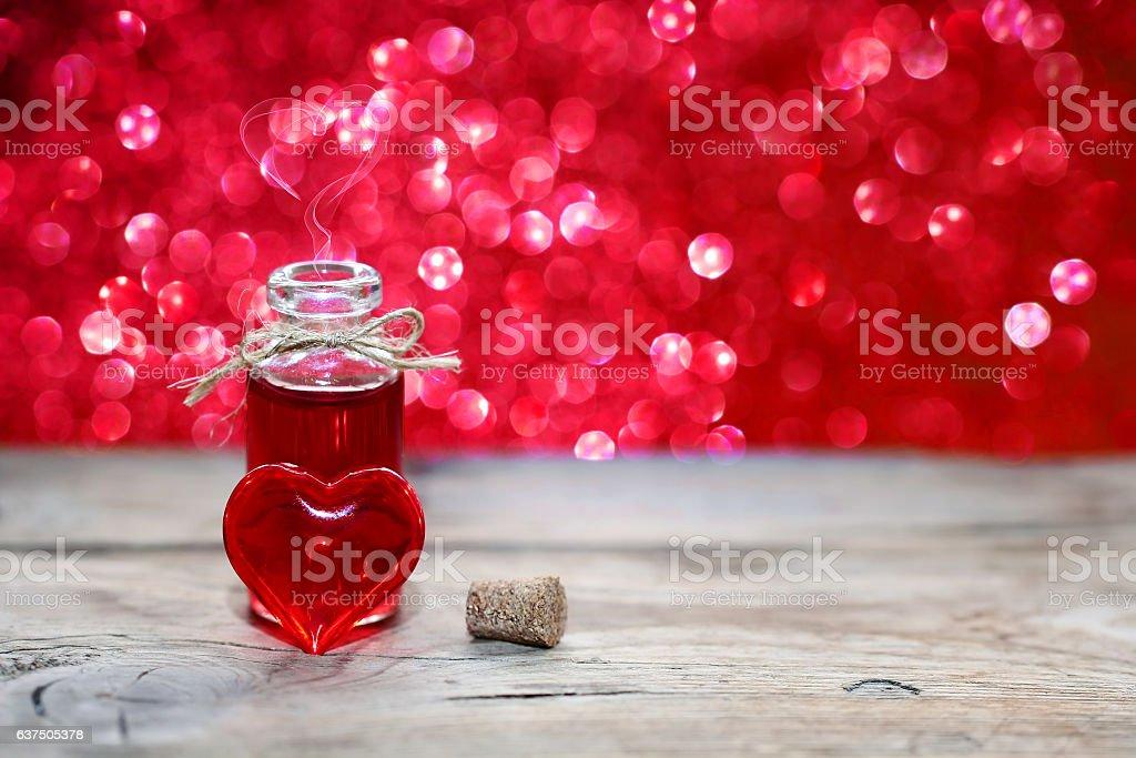 open bottle of love potion stock photo