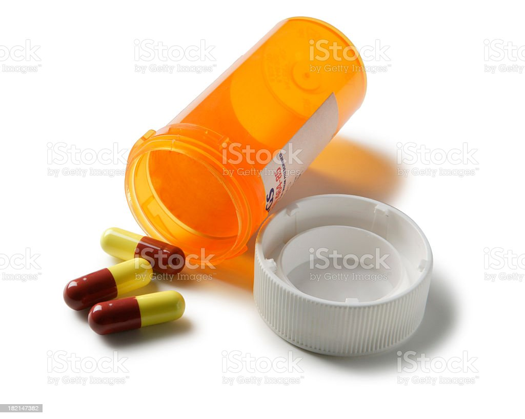 Open bottle of prescription drugs isolated on white background stock photo