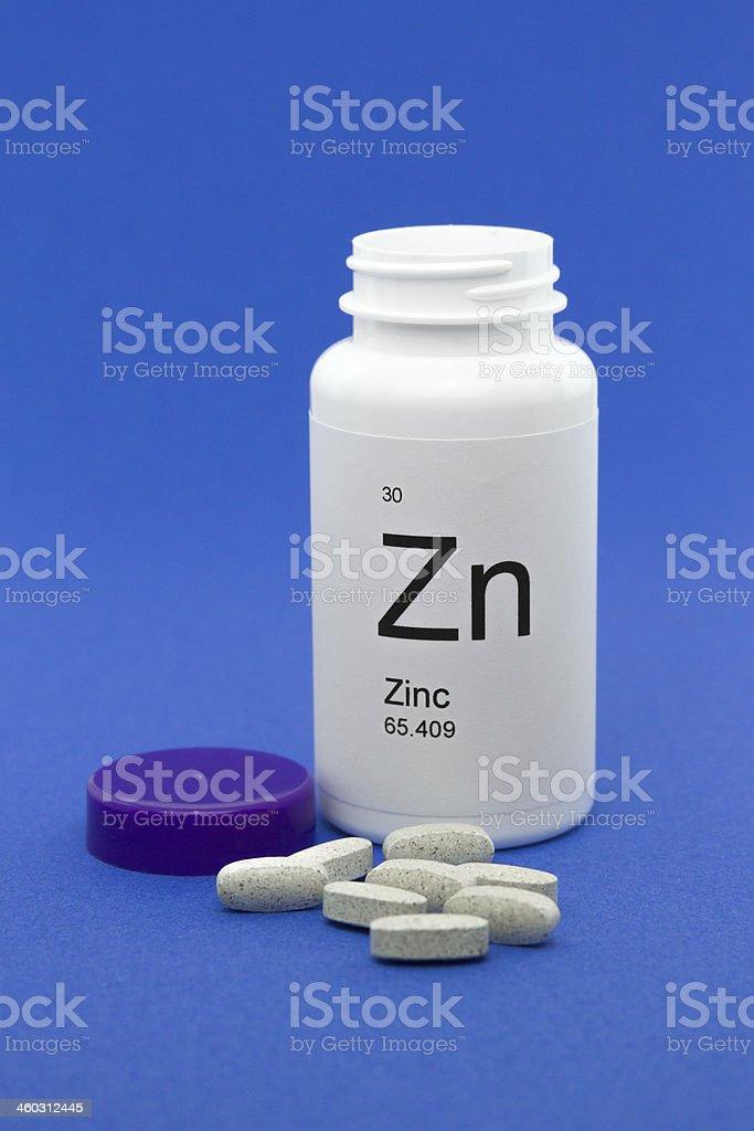 Open bottle of Zinc vitamins stock photo