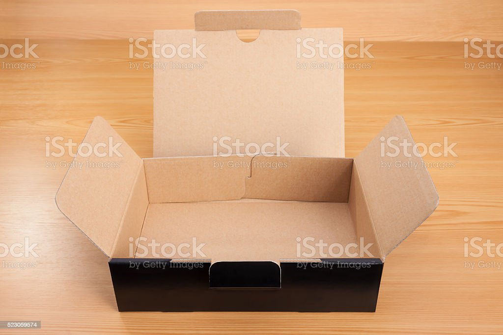 Open blank black box mock up on wood background.
