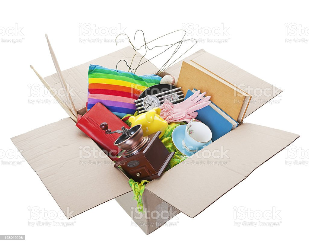 Open box with various household items inside stock photo