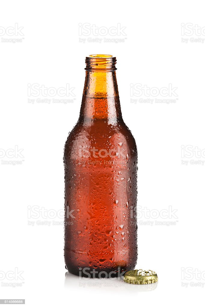 Open brown beer bottle on white backdrop stock photo