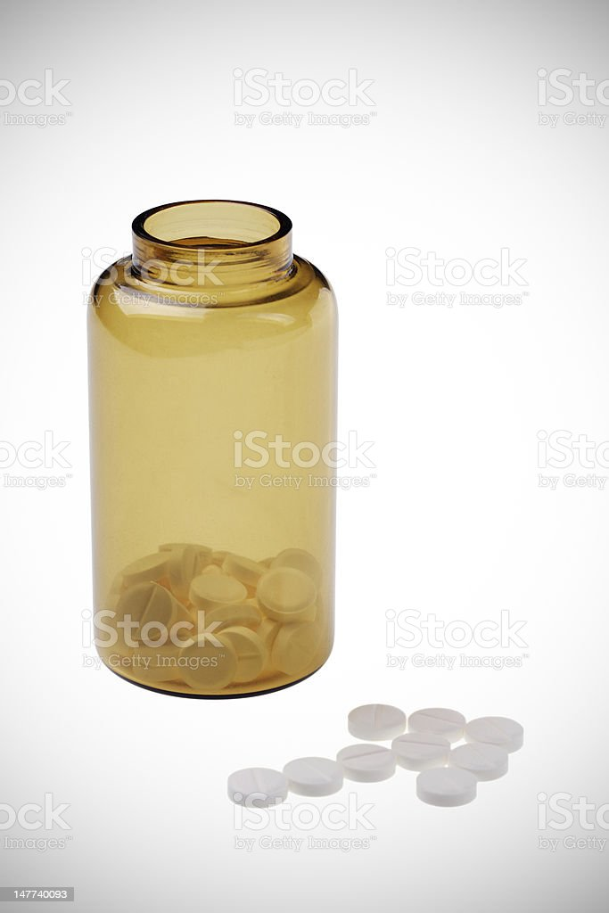 Open brown jar with arrow of pill royalty-free stock photo