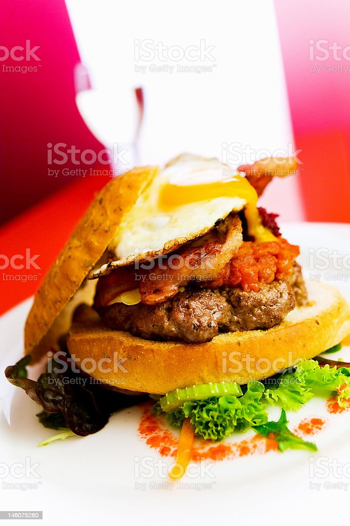 Open burger on a white plate stock photo
