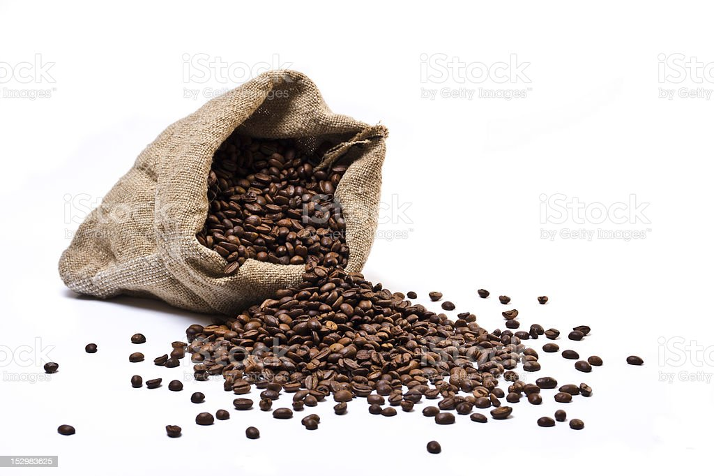 Open burlap sack with coffee beans spilling out stock photo