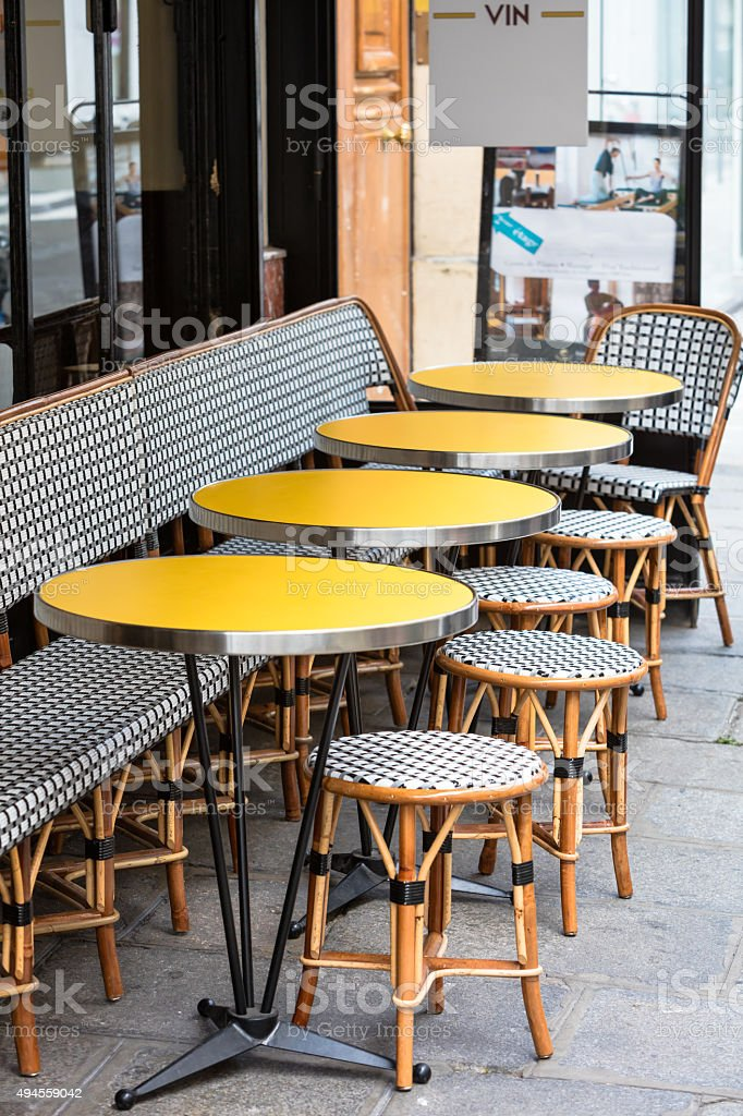 Open cafe terrace, round tables and wicker chairs, Paris, France stock photo