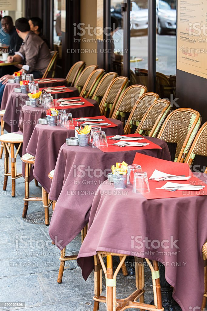 Open cafe terrace, round tables and wicker chairs, Paris, France royalty-free stock photo