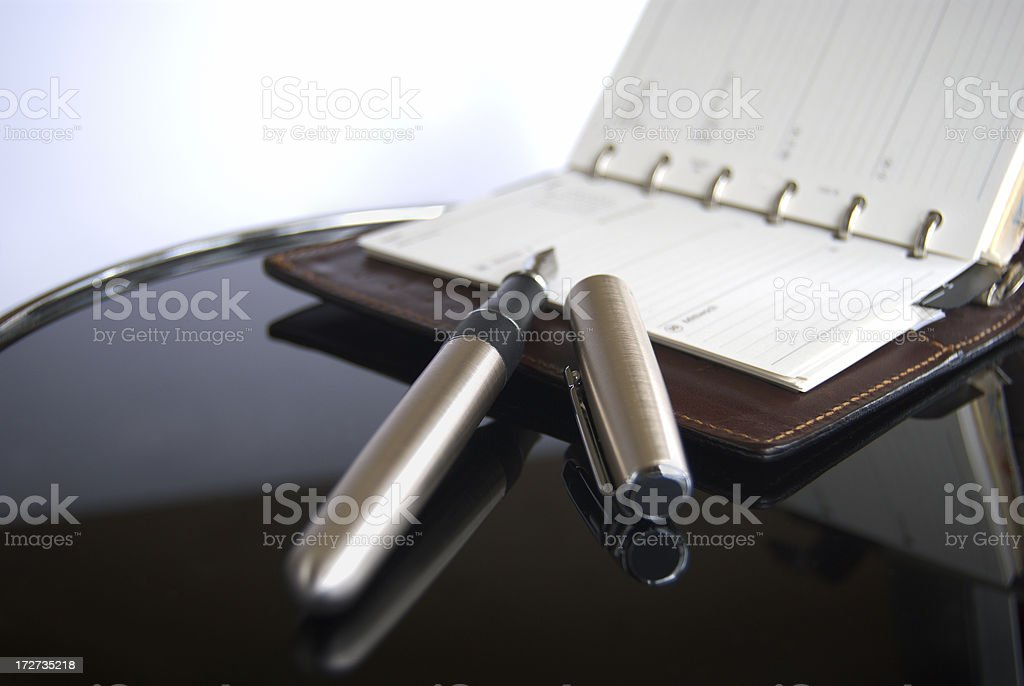 Open calendar and fountain pen with the cap off royalty-free stock photo