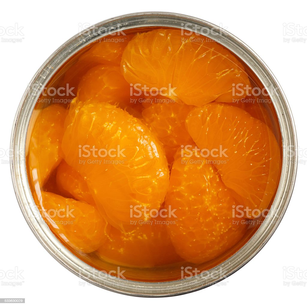 Open can of mandarins in light syrup. stock photo