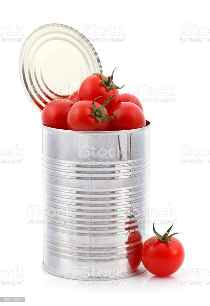 Open can with fresh tomatoes inside stock photo