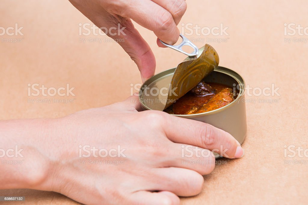 open canned fish by ring pull stock photo