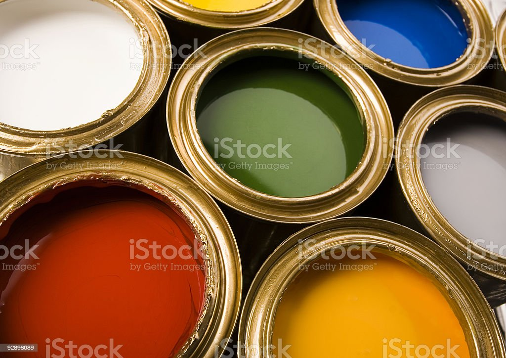 Open cans of paint in different colors royalty-free stock photo