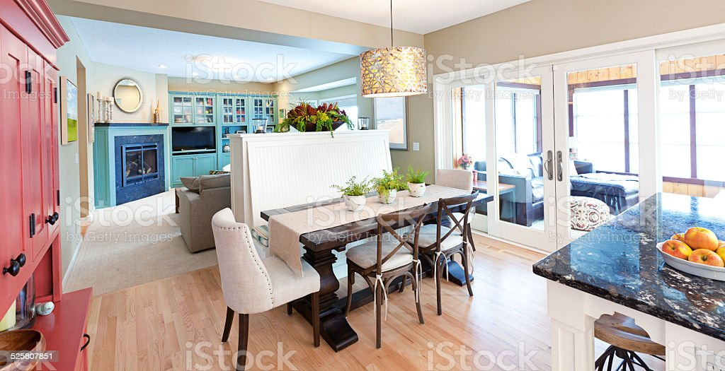 Open Concept Interior Design with Family Den Dinning and Kitchen stock photo