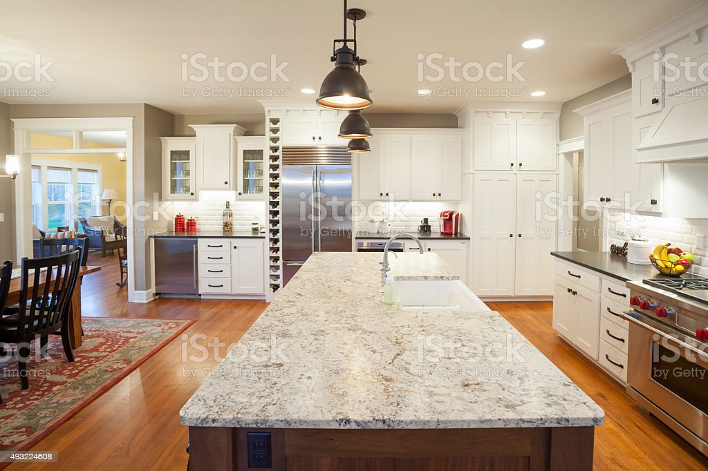 Open Concept Kitchen and Dining Room With Marble Center Island stock photo