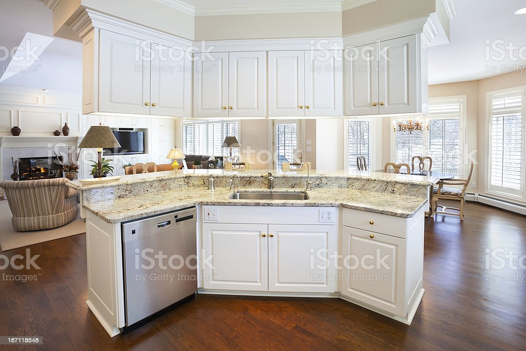 Open Concept Kitchen Island With Marble Counter royalty-free stock photo
