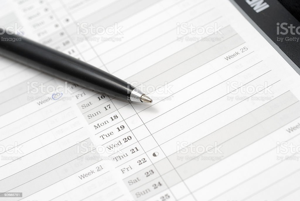 Open day planner with a ballpoint pen stock photo