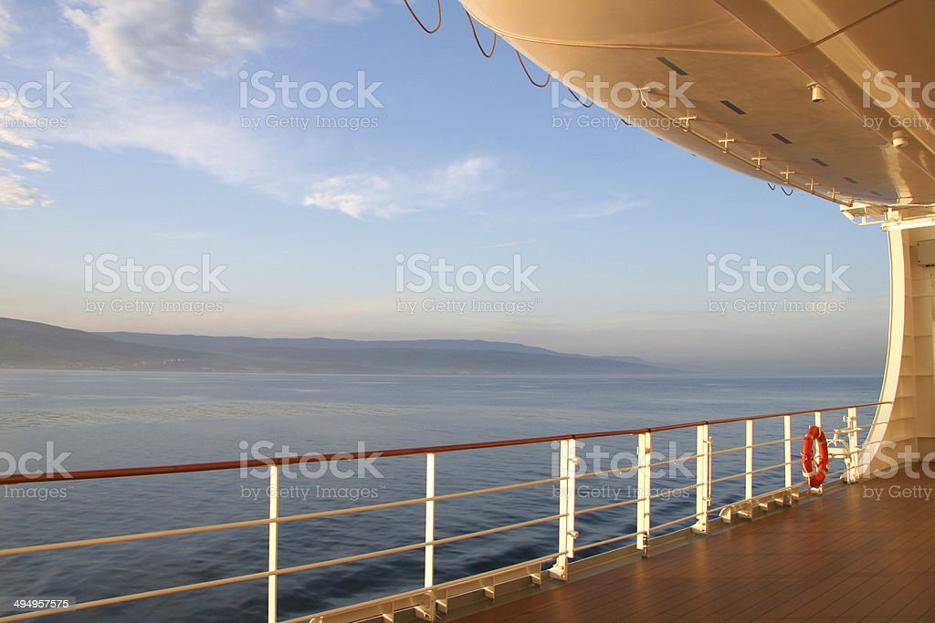 Open deck of a cruise ship at sunset. stock photo