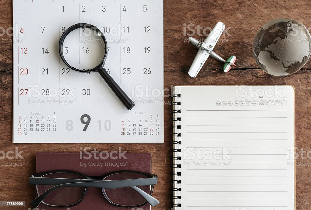 Open diary and calendar with passport stock photo