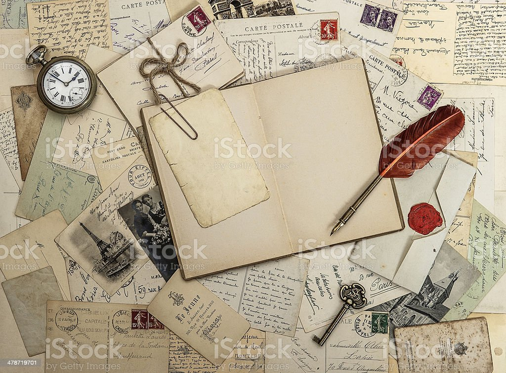 open diary book, old accessories and postcards stock photo