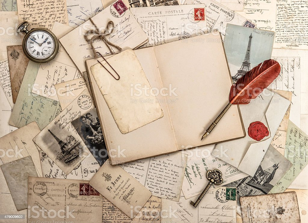 Open diary book, old accessories and postcards. Vintage background stock photo