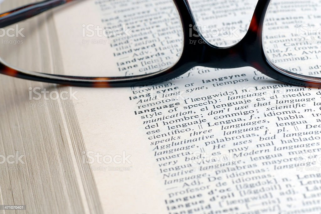 Open dictionary with word language stock photo