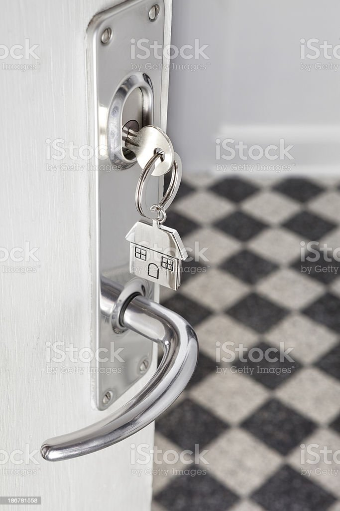Open door and house key stock photo