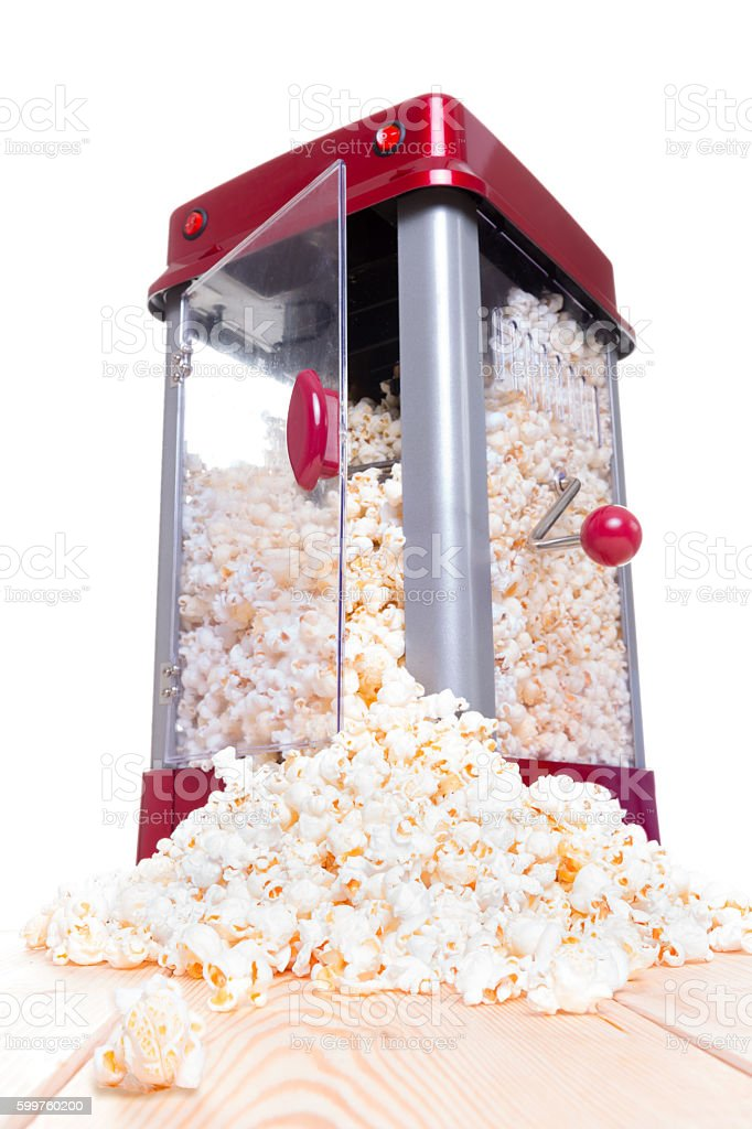 Open door popcorn popper with food pouring out stock photo
