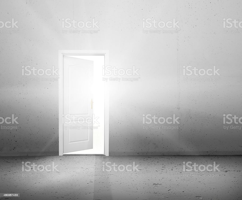 Open door to a better world, light shining through doorway stock photo