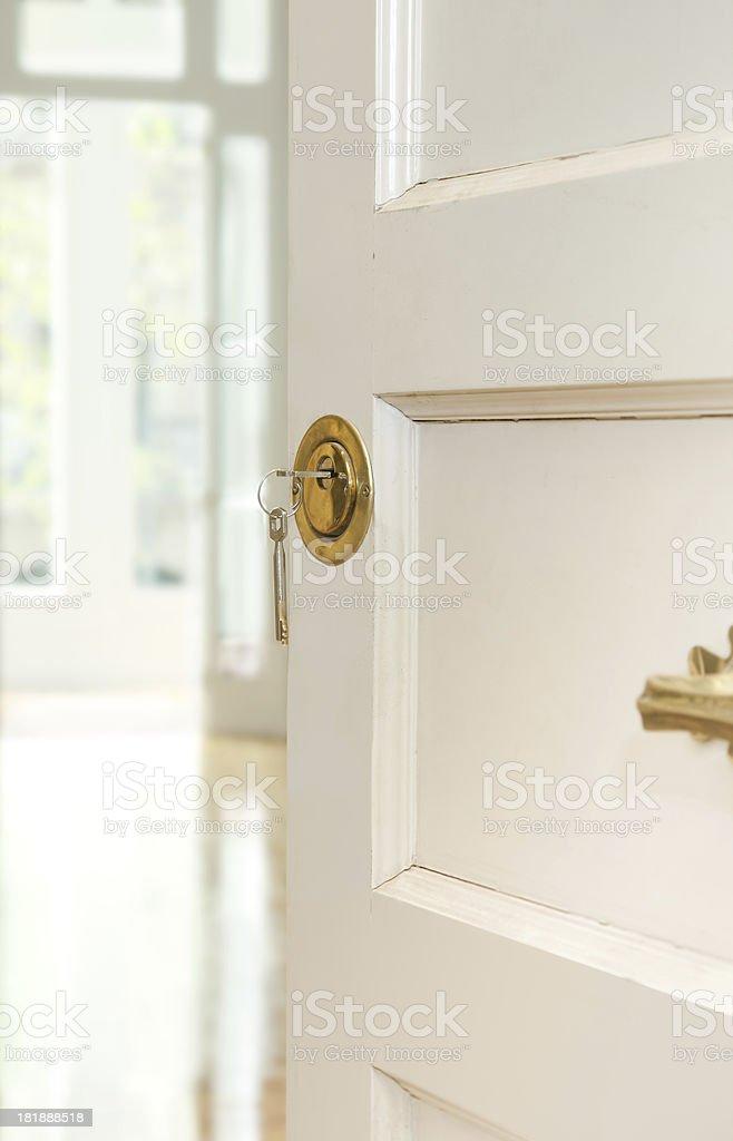 Open door with keys on lock stock photo
