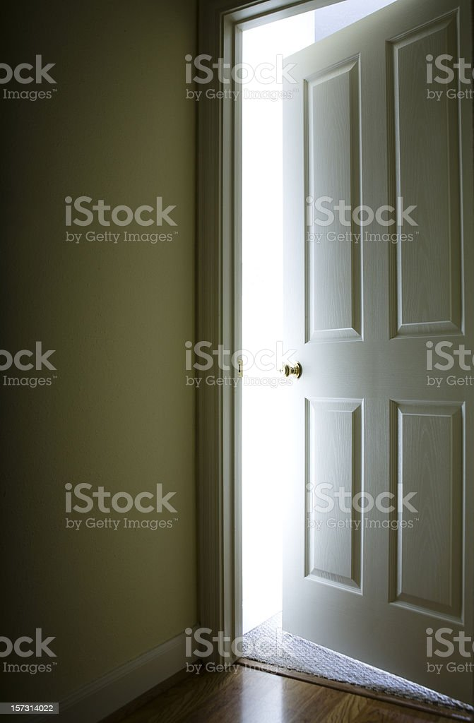 Open door with light behind stock photo