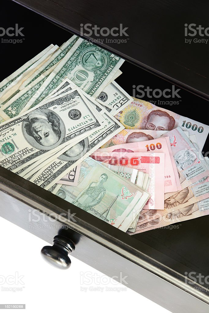 Open drawer with american and thai banknotes royalty-free stock photo