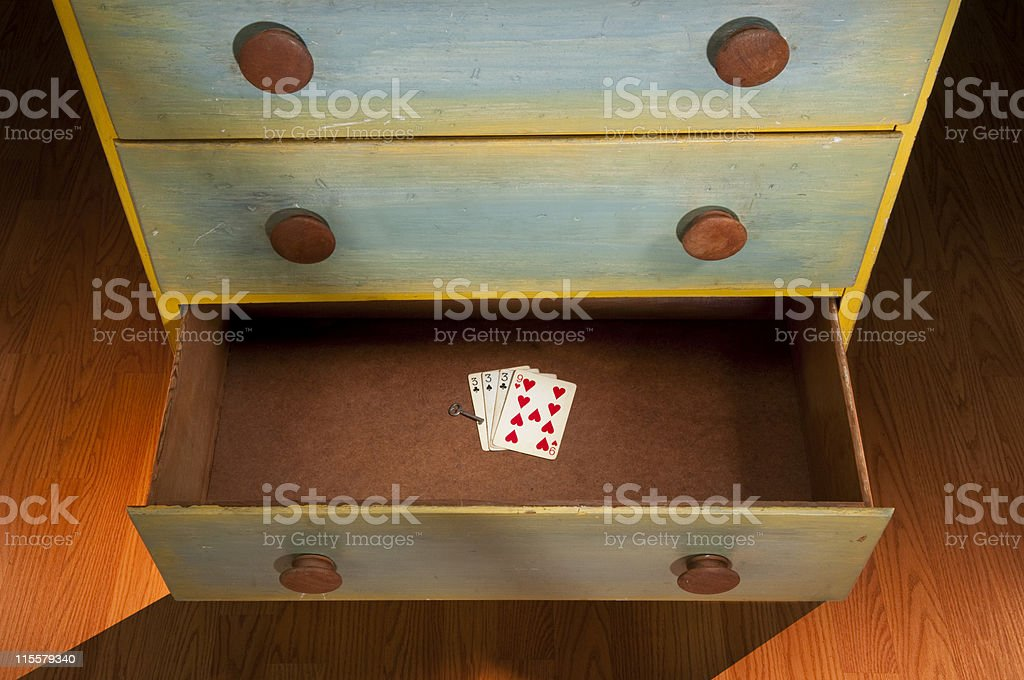 Open Drawer With Playing Cards & Key stock photo