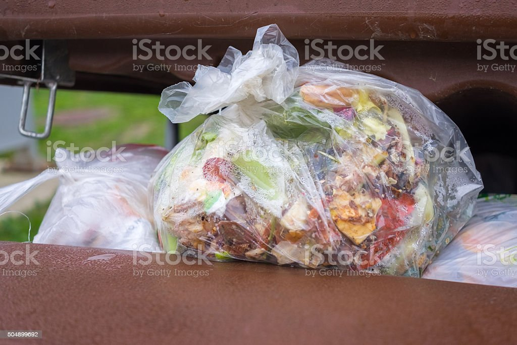 open dumpster full of trash stock photo