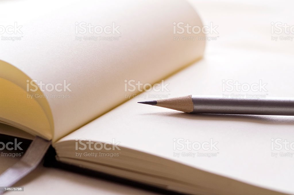 A open empty book and a pencil royalty-free stock photo