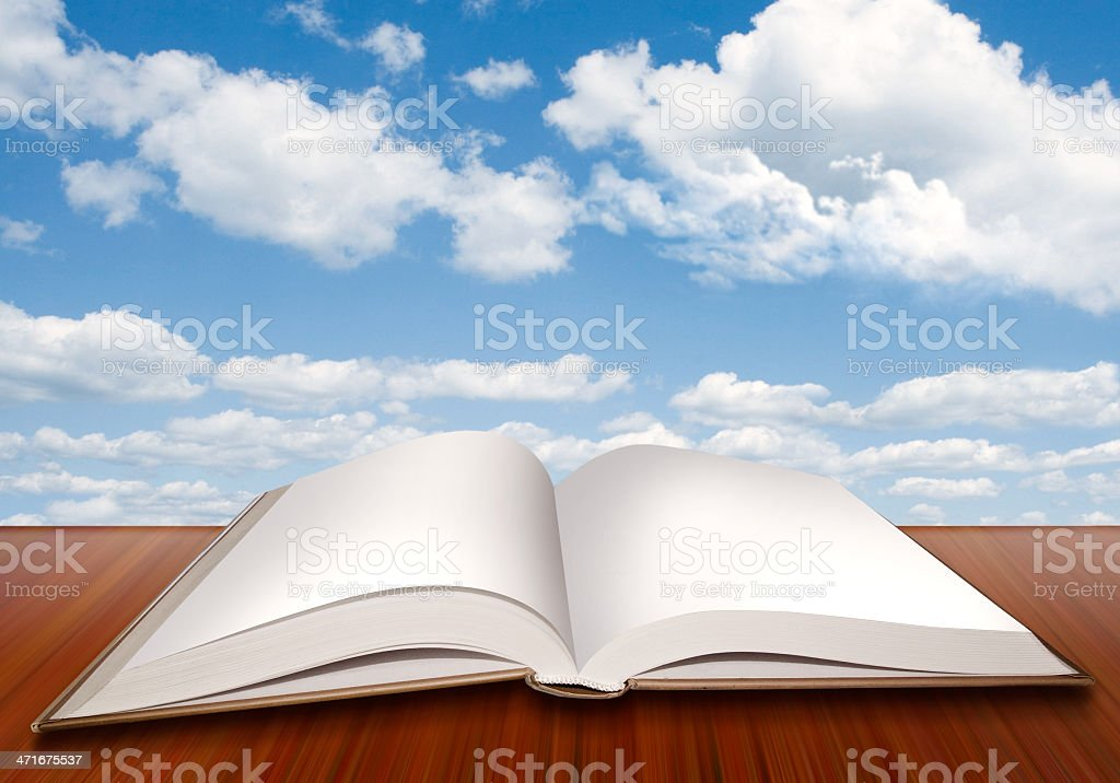 Open empty book with blank pages and blue sky royalty-free stock photo