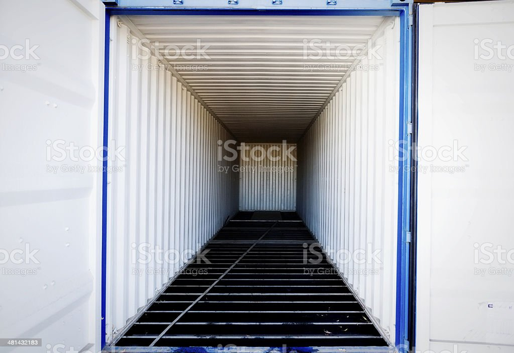 Open empty shipping container shows diminishing perspective in abstract view stock photo