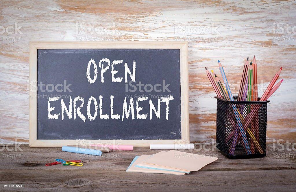 Open Enrollment text on a blackboard stock photo