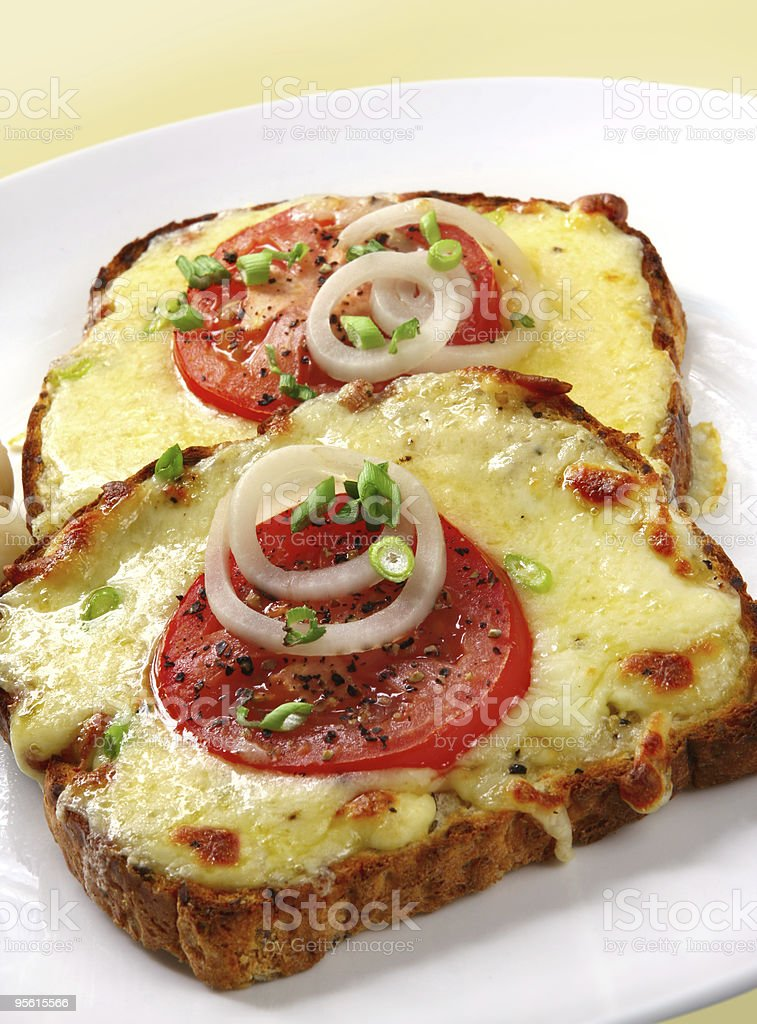 Open faced grilled cheese sandwich with tomato and onion stock photo