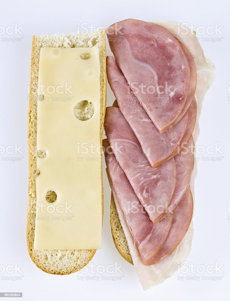 Open faced turkey, swiss cheese, and ham sandwich royalty-free stock photo